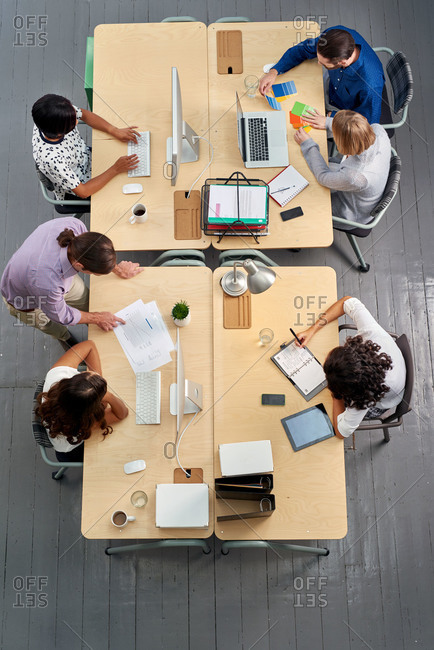 Overhead view of coworkers in open plan office