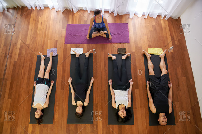 Yoga class lying down on mats to cool down