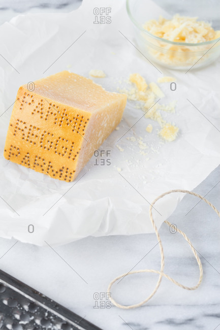 Parmesan reggiano cheese and wax paper