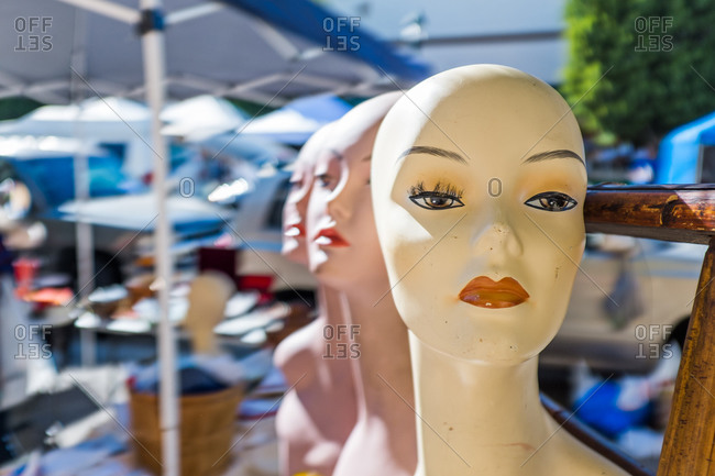 Mannequin heads at an outdoor flea market