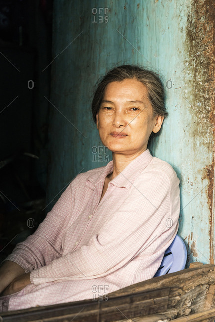 Phu Quoc, Vietnam - April 16, 2015: Portrait of a Vietnamese woman sitting next to a window