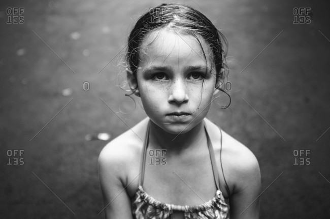 Portrait of a determined -looking young girl in swimsuit