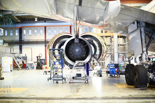 Plane engine being repaired in a hangar