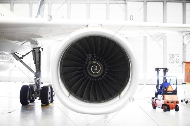 Plane engine in a hangar
