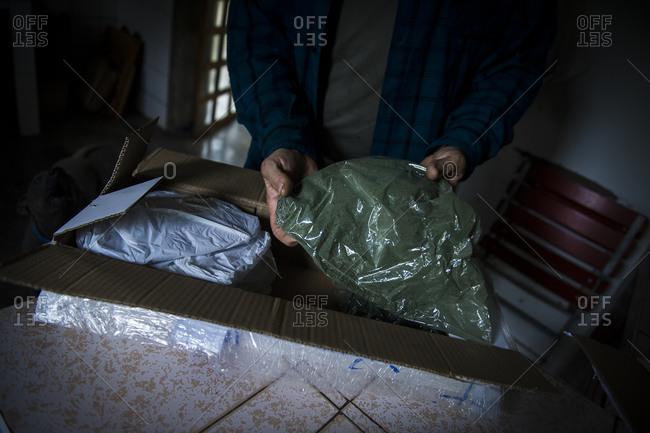 A farmer in Peru receives biodynamic fertilizer in the mail