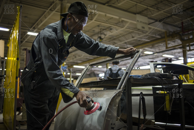 July 18, 2014: A workers cuts a custom made doors for armored limos in a car factory