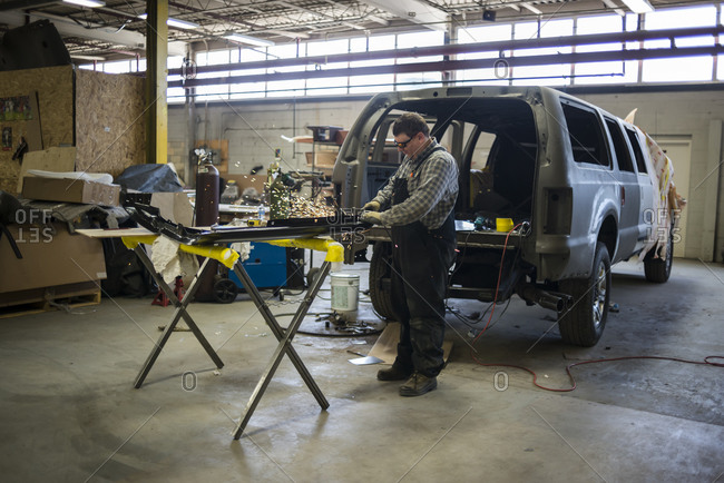 July 18, 2014: A heavy duty SUV is being extended at a vehicle armoring factory