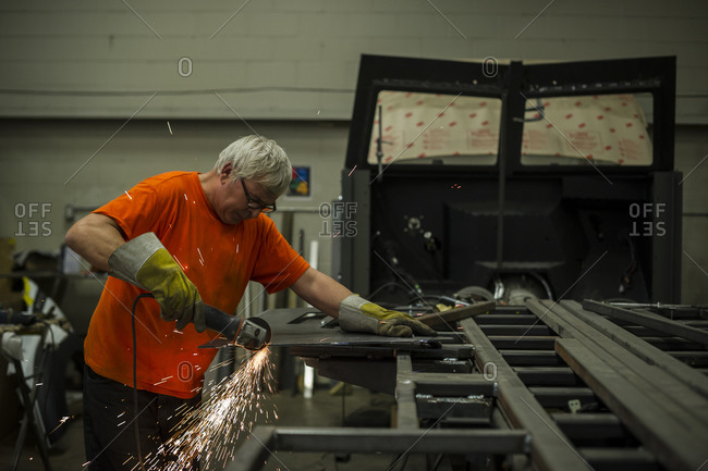 July 18, 2014: A worker cuts the frame of an armored personnel carrier