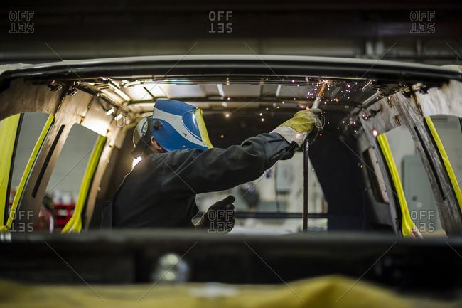 July 18, 2014: A man welds an armored van