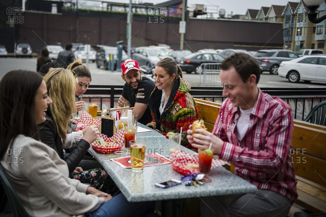 April 12, 2014: Patrons enjoy burgers on an outdoor  patio of a restaurant in downtown Toronto
