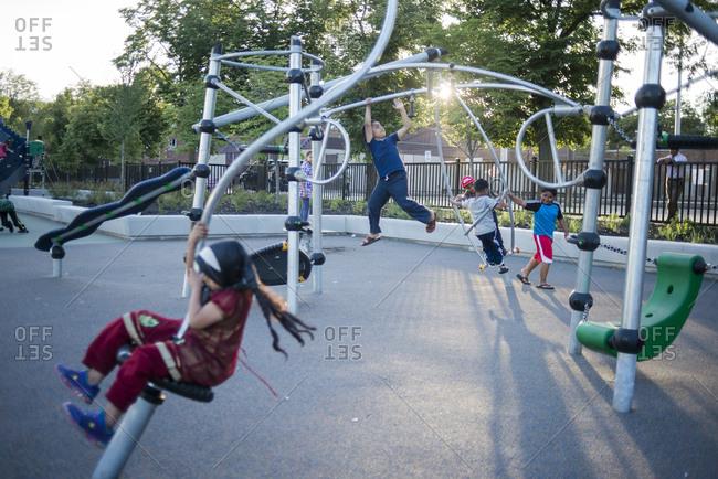 June 21, 2014: Children play in the new playground in Regent Park, Toronto, Canada
