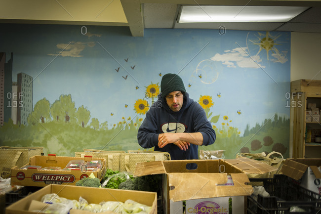 April 2, 2014: A volunteer packs food for distribution at an urban farm in Toronto, Canada