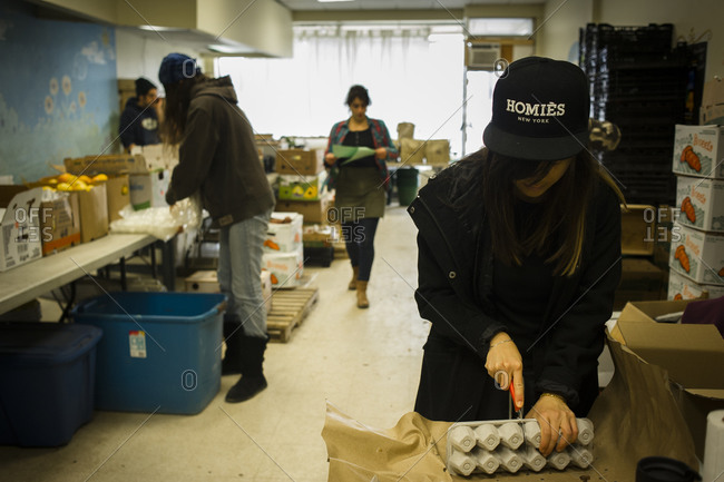 April 2, 2014: A volunteer prepares eggs for distribution at an urban farm in Toronto, Canada