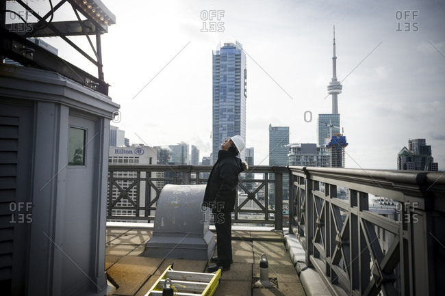 February 25, 2014: Workers change the bulbs on the Canada Life Insurance building in downtown Toronto, Canada
