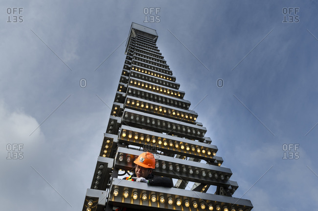 February 25, 2014: A worker changes the bulbs on the Canada Life Insurance building in downtown Toronto, Canada
