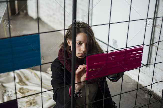 March 27, 2014: A woman at a yarnbombing event to launch the opening of a new housing development in Toronto