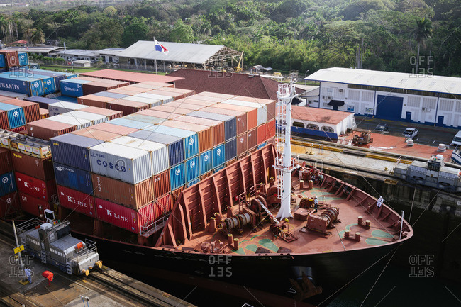 Panama Canal, Panama - January 24, 2015: Cargo ship passing through the Gatun Locks in Panama