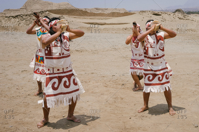Lima, Peru - January 29, 2015: People dressed as ancient Incans perform a traditional ritual
