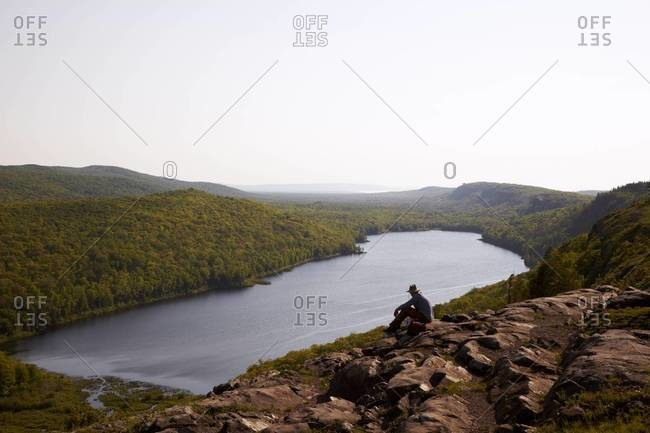 Hiker looking at view of a mountain lake