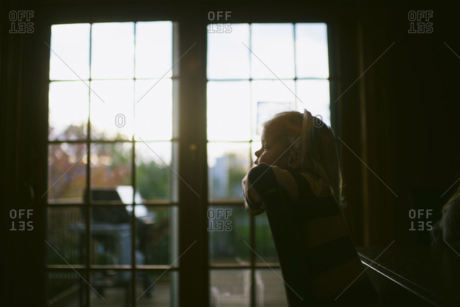 Girl at home in front of French doors