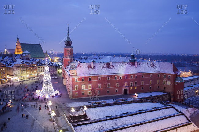 View to Castle Square with lighted Christmas tree at historic city center by night, Warsaw