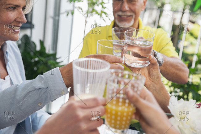 Family toasting with water and juice