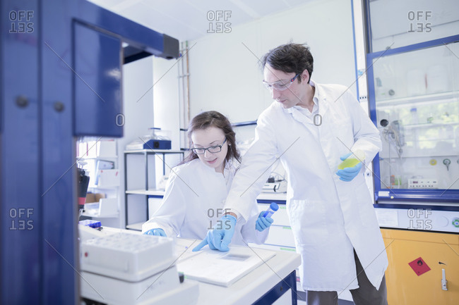Lab technicians discussing in lab