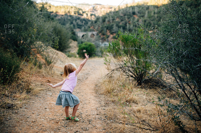 Little girl dancing on a path