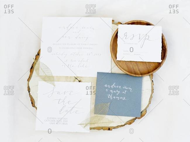 Wedding invitations laid out on a stump