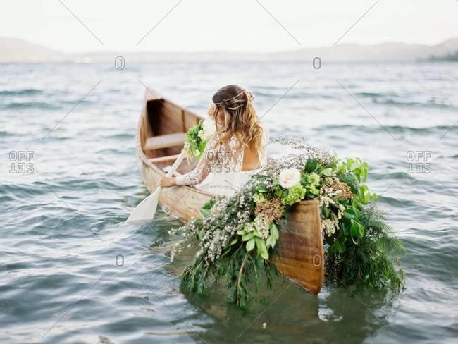 Bride paddling a canoe