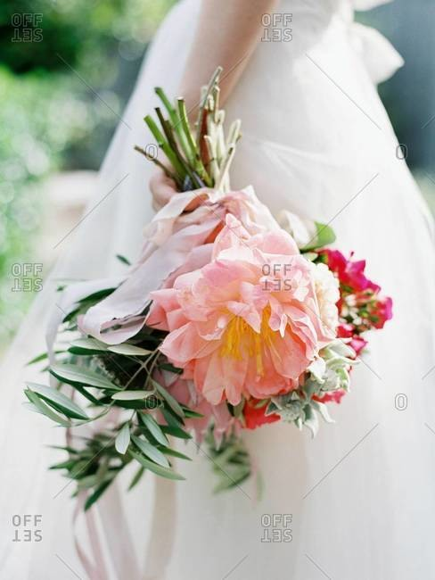 Woman holding her bridal bouquet