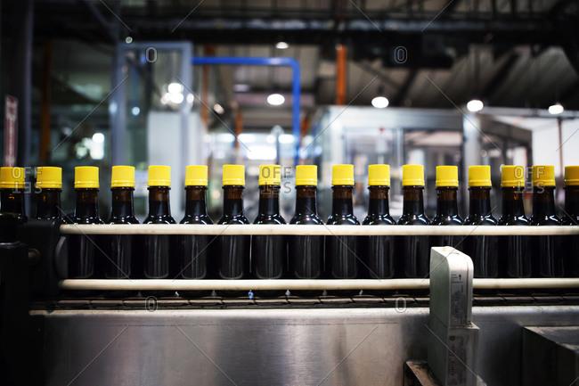 Filled bottles on a bottling plant conveyor belt