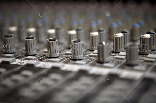 Dials on a mixing board at a recording studio