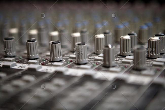Dials on a mixing board at a recording studio