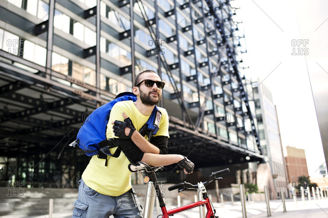 Man leaning on a bike seat