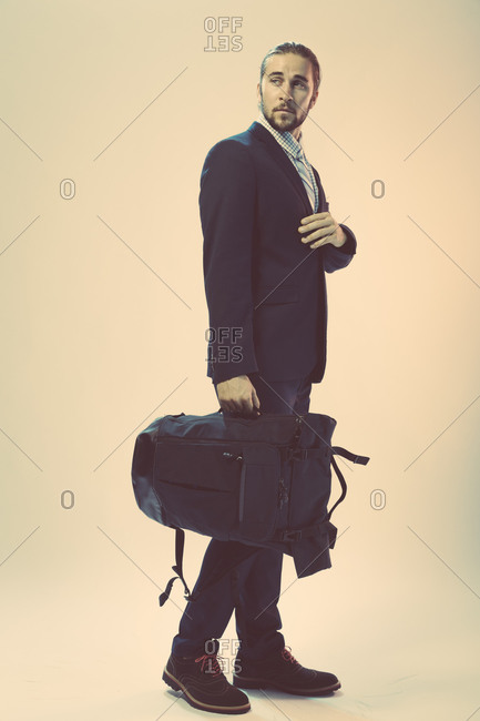 Man in formal wear carrying a backpack