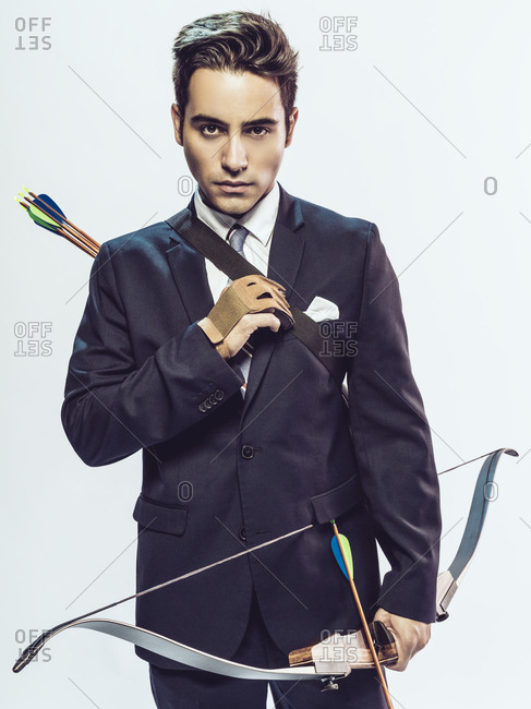Man in work attire holding a bow and arrow