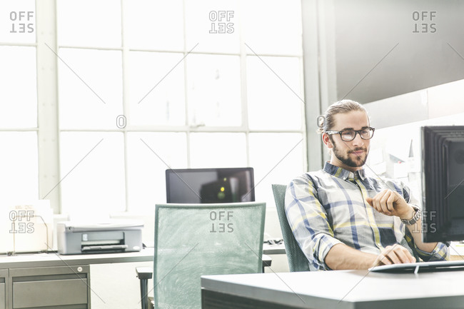 Young man working at a desktop computer