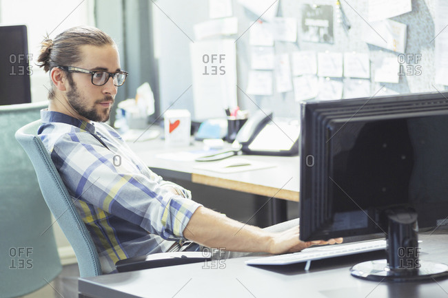 Man working at a desktop computer