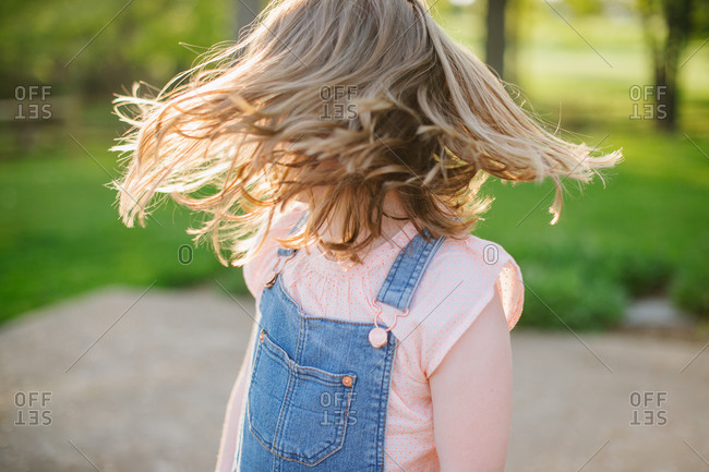Girl spinning around in the sunlight