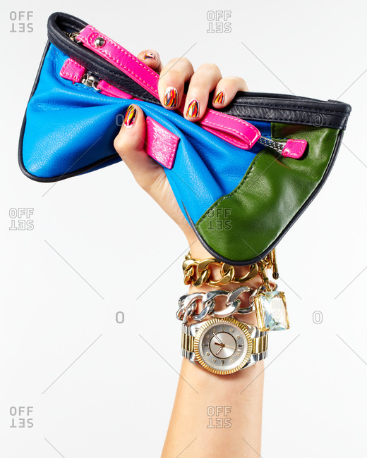 Hand holding up a colorful cosmetics bag