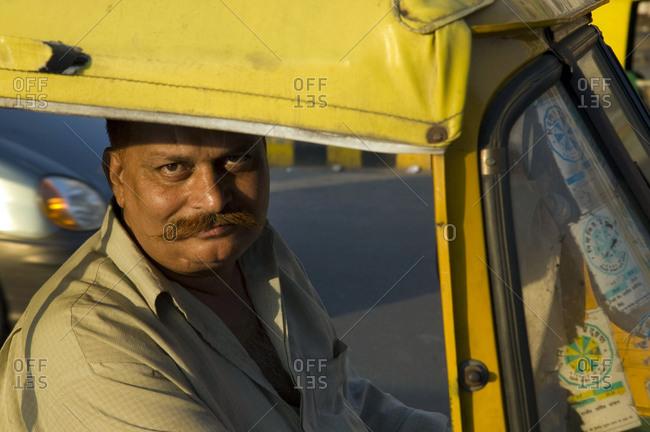 Delhi, Indian - March 14, 2002: Portrait of a taxi driver in Delhi, India