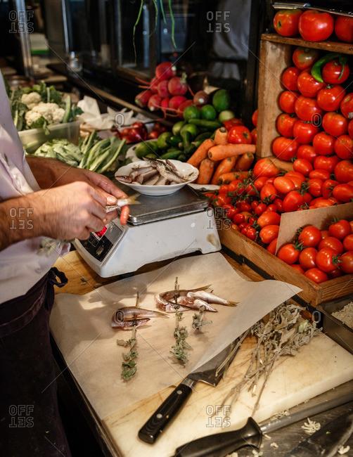Cook preparing food in Tel Aviv restaurant