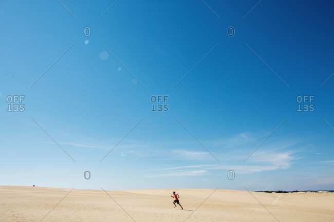 A boy running in the sand