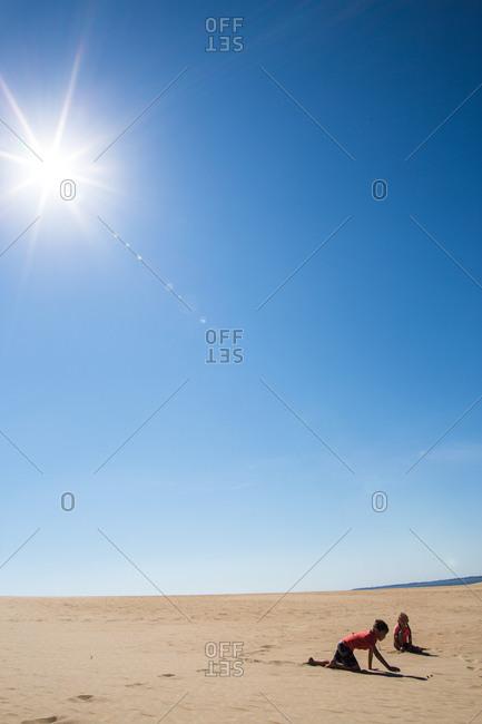 Children play in desert sand