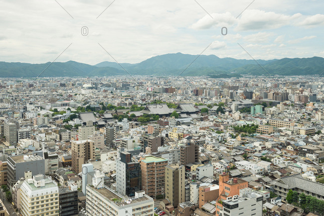 July 12, 2015: Kyoto cityscape surrounded by mountains