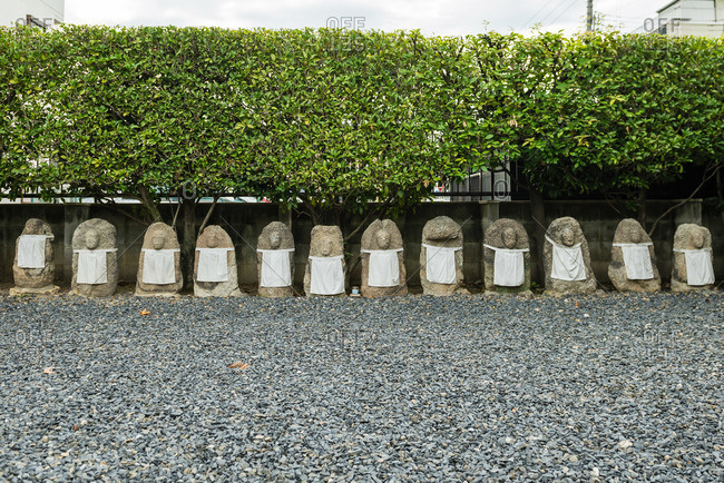 Row of diety statues in Japanese garden