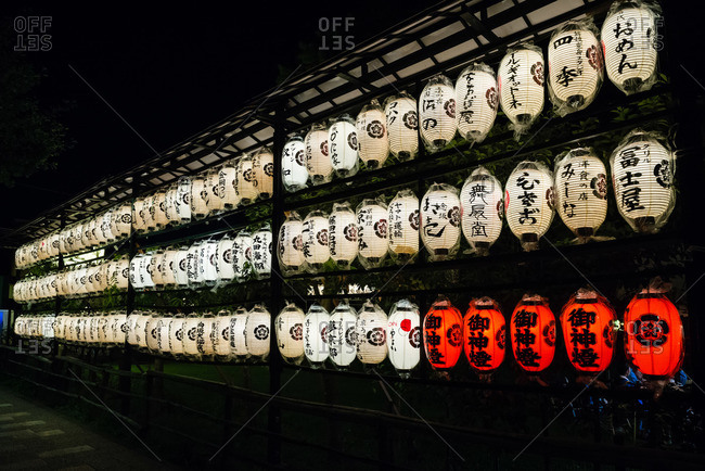 July 12, 2015: Rows of white lanterns at night with five red ones in the lower right corner