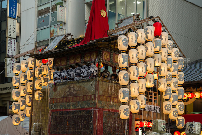 Kyoto, Japan - July 13, 2015: Men in ceremonial robes ride on a float in the Gion Matsuri Festival in Kyoto