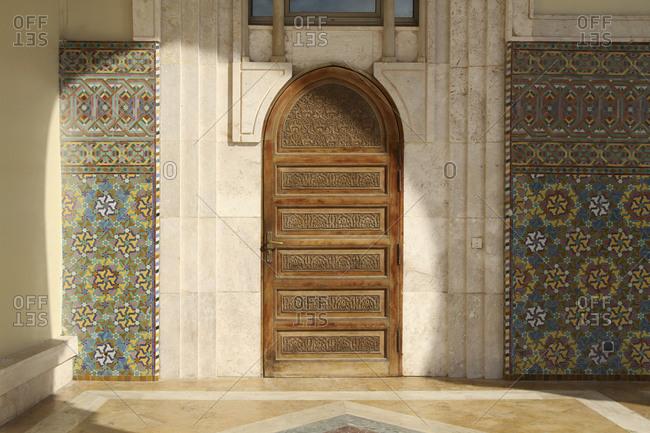 Casablanca, Morroco - June 8, 2015: Wooden door at Hassan II Mosque